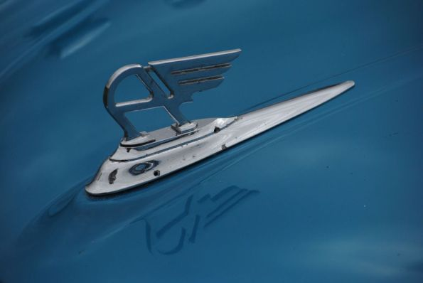 blue bonnet with hood ornament of an vintage austin