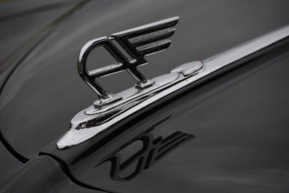 black bonnet with hood ornament of an vintage austin