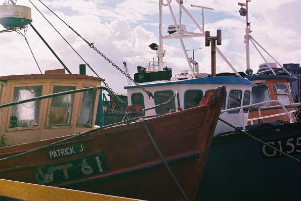 Three small fishing boats in Galway harbour